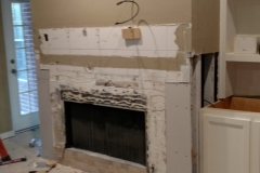Before: Stone Fireplace with wood mantle