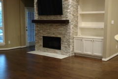 After: Stone Fireplace with wood mantle