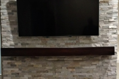 Stone Fireplace with wood mantle close up