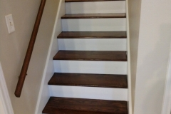 After: Freshly stained wood and railing along with new white painted risers