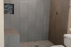 Bathroom remodeling contractor updating shower in Cypress, TX home