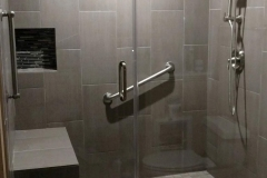 After: ADA remodeling walk in shower with grab bar in Sugar Land home