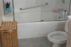 Before: ADA remodeling walk in shower with grab bar in Sugar Land home