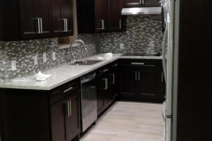 After: Custom kitchen remodeling in Katy, TX with dark cabinetry