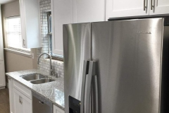 After: Custom kitchen remodeling stainless steel appliances