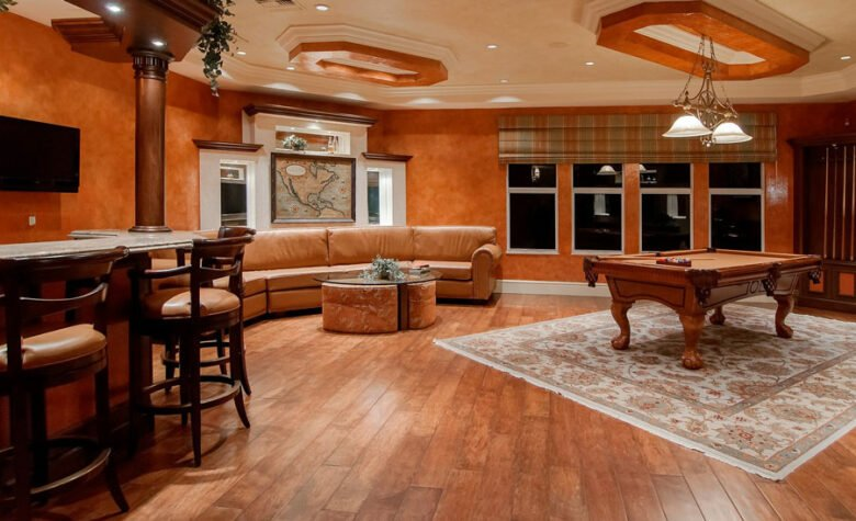 Rec room home additions in Katy, Texas with bar and game table